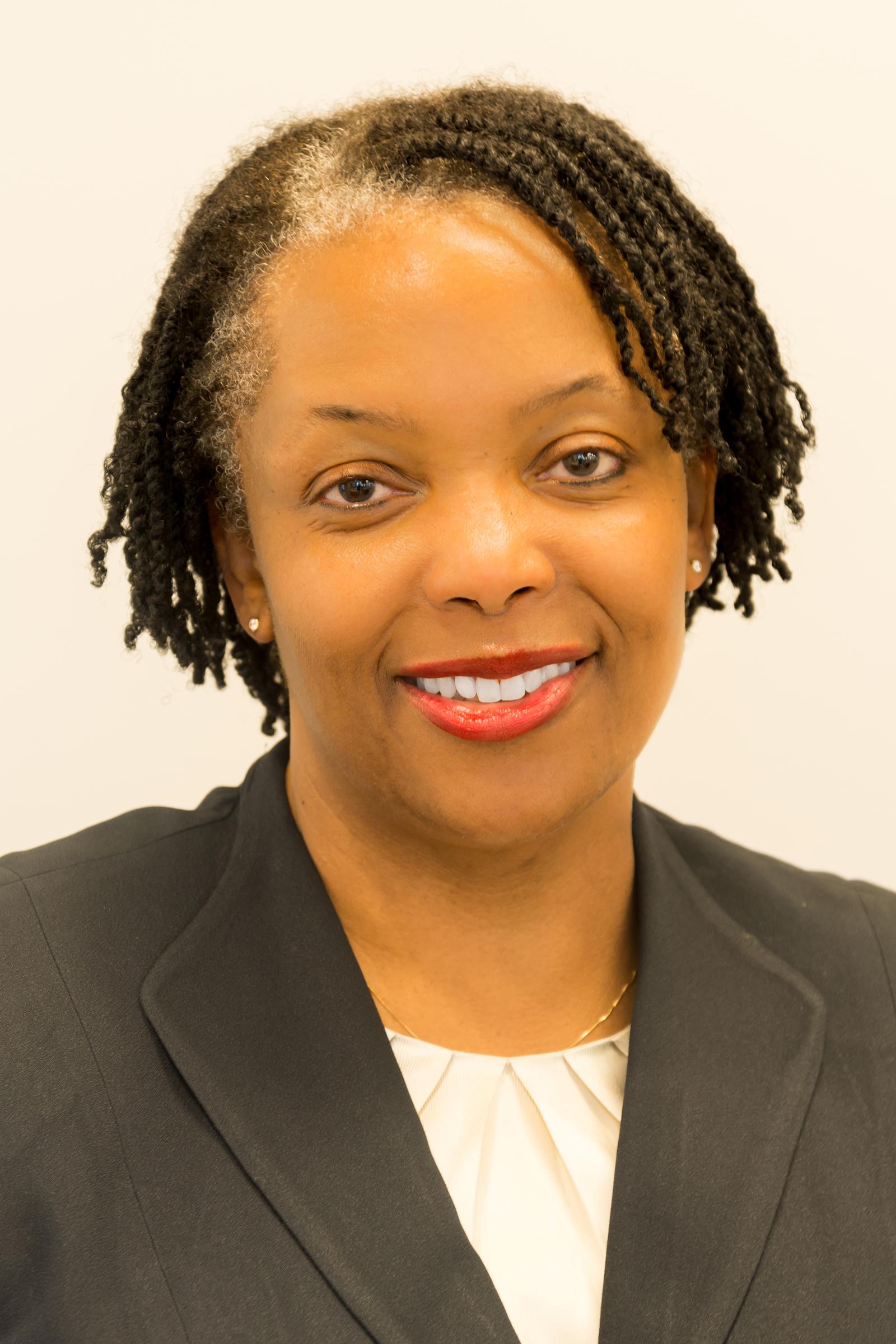 Tina E. Patterson, Commissioner