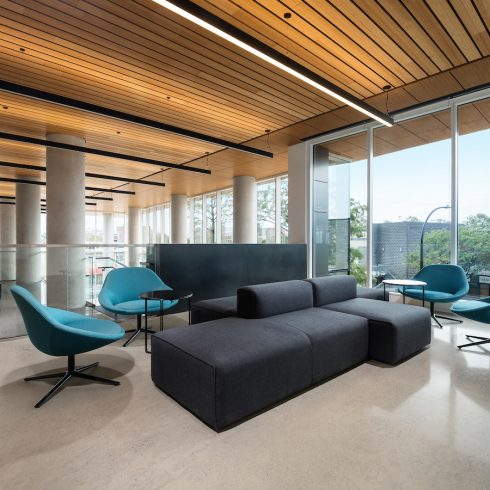 Seating area by floor-to-ceiling windows