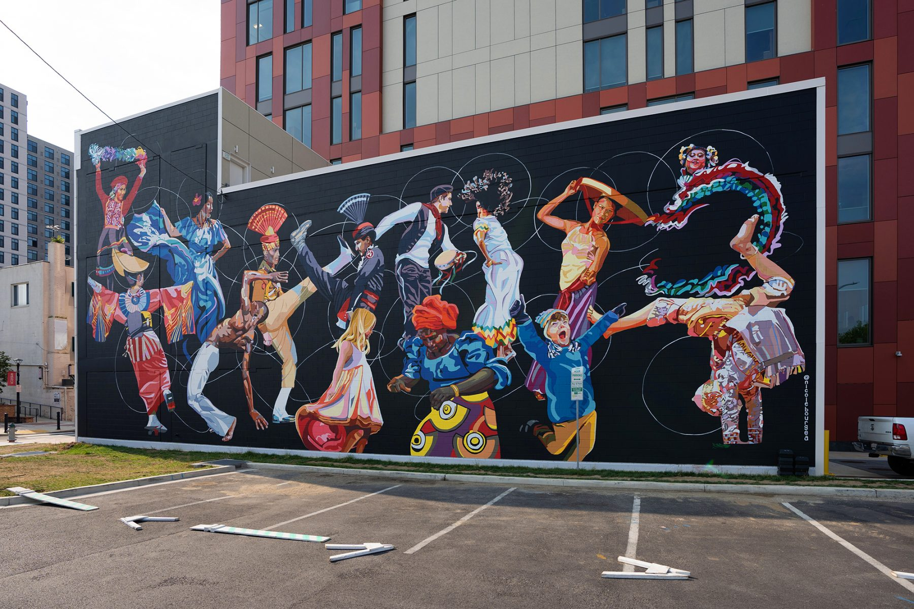 Bold, colorful mural of dancers