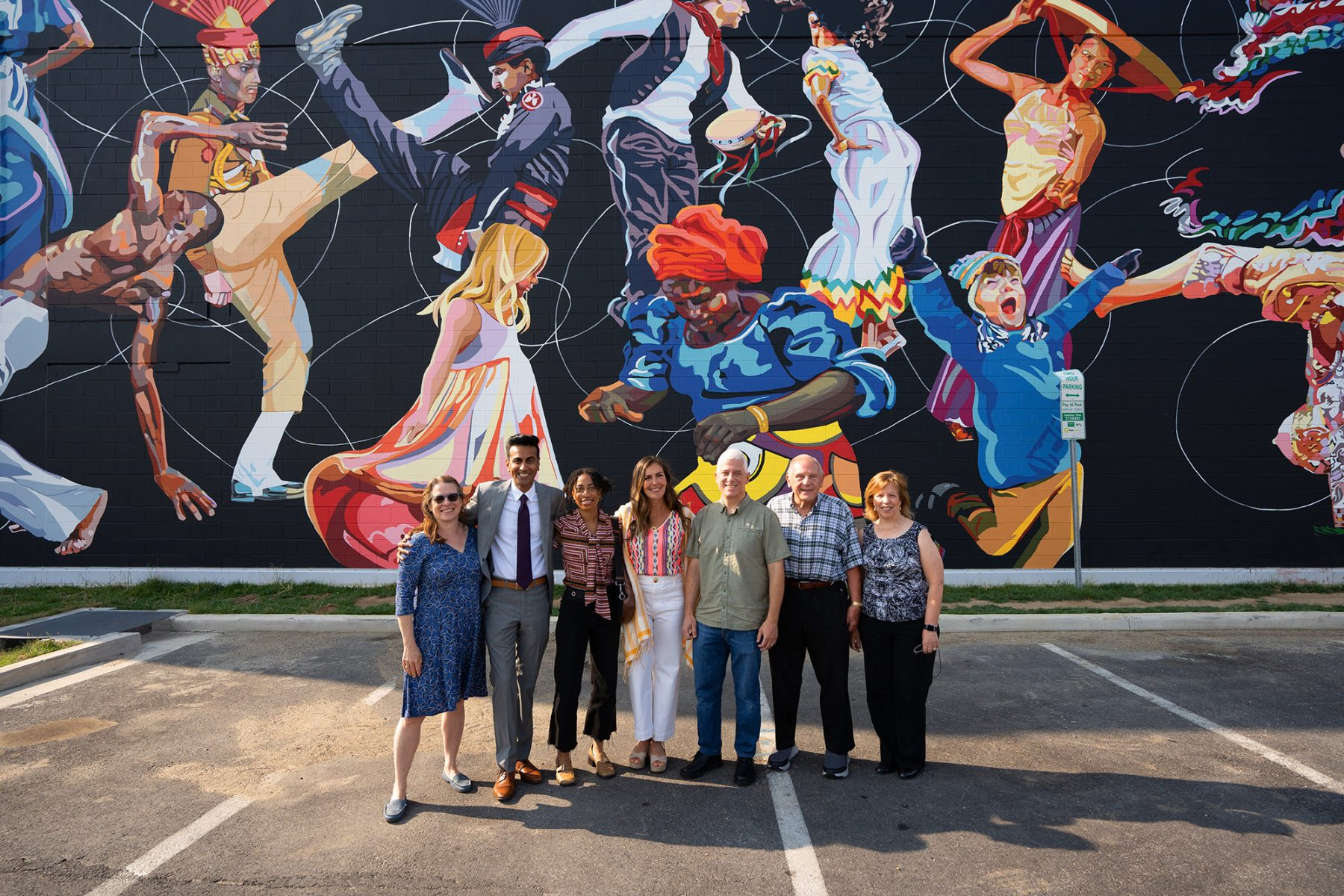 Artist Nicole Bourgea with Planning Board members in front of finished mural