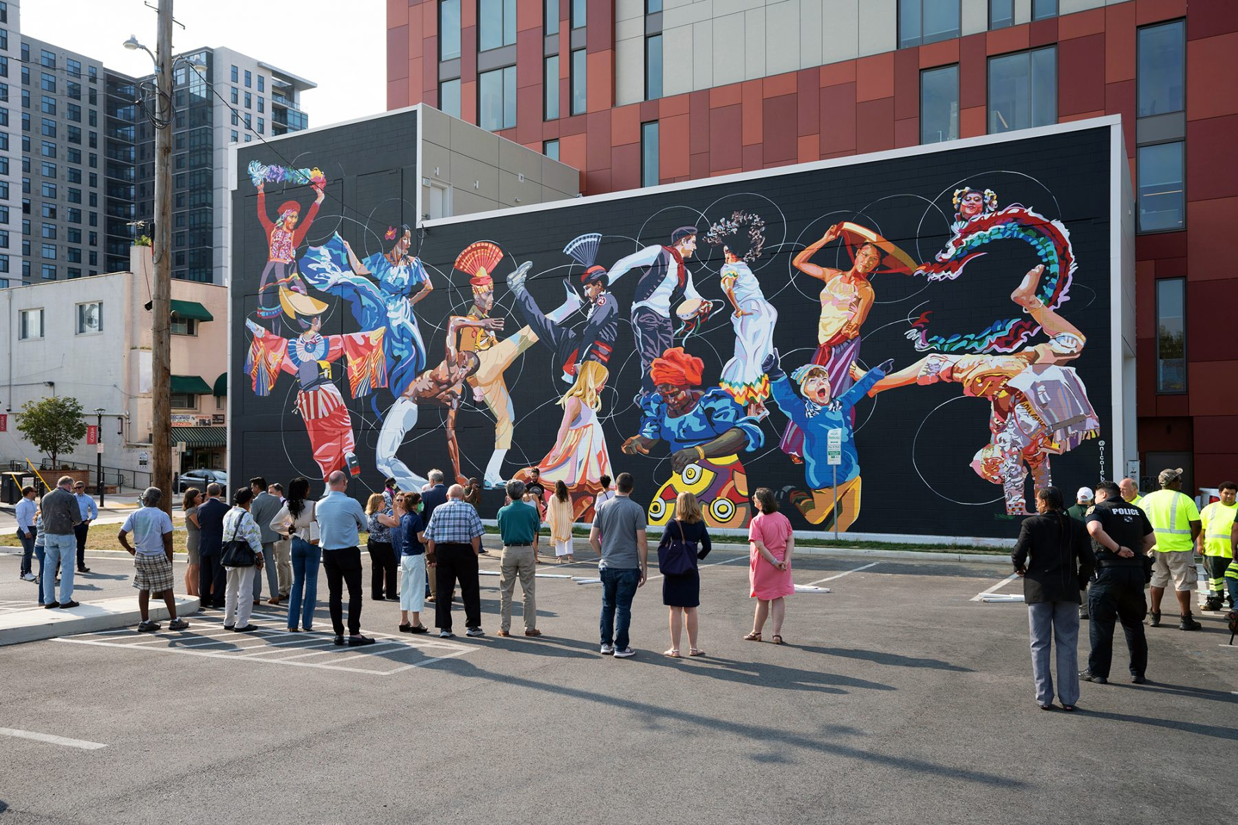M-NCPPC employees gathered to view completed mural